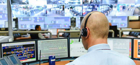 a guardian in a control room of a prison. © Fotolia