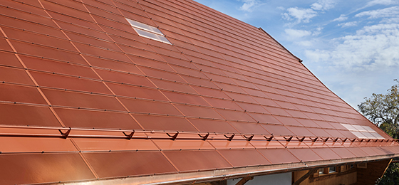 This photo shows the roof of a farmhouse with active terracotta tiles based on monocrystalline silicon cells.