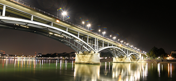 The image shows a brightly lit bridge.